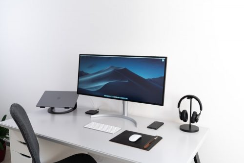 What is a compact computer desk?